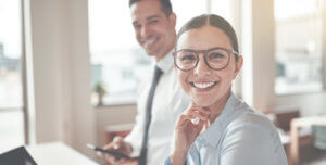Business partners smiling because accounts receivable factoring helped their business